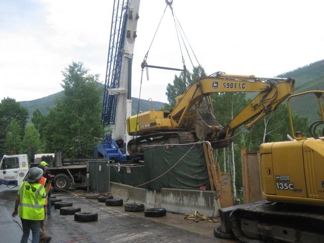 excavator at road